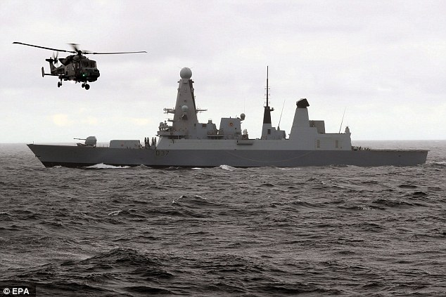 British Royal Navy type 45 destroyer HMS Duncan is pictured with its Wildcat helicopter as it shadows the Russian Carrier Task Group in the English Channel last week