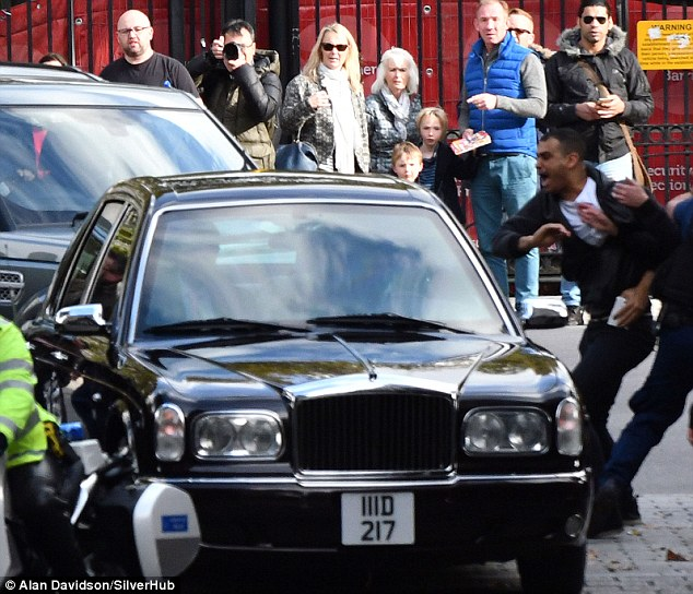 Anger: A protester throws himself at the car carrying the King of Bahrain as it entered Downing Street today