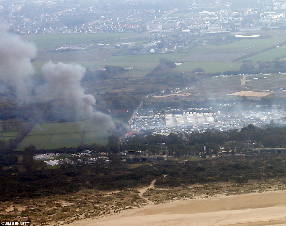 This aerial photo shows how the fire was started near an entrance to the camp and has since spread through the make shift shelters