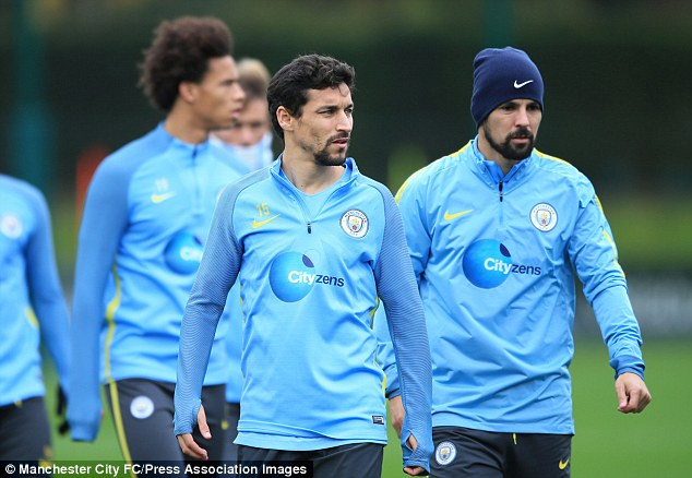 Spanish duo Jesus Navas and Nolito (right) warm up for City's next Premier League clash