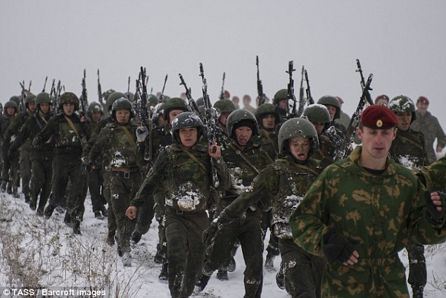 While Russia 'means business' having sent warships past British shores and displayed its military might, Moscow is 'weak' and does not want a war, Sir Anthony Brenton said. Russian troops are pictured in the Novosibirsk region of Russia earlier this month