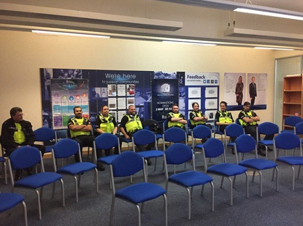 Protecting Chester... the force of eight: Sitting bemused in their briefing room, outnumbered by empty chairs, this was the police night shift expected to keep safe the city of Chester – population 120,000 – on one night last month
