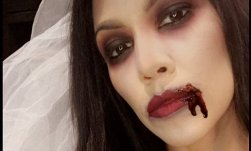 Kourtney Kardashian wears face paint to look like a zombie
