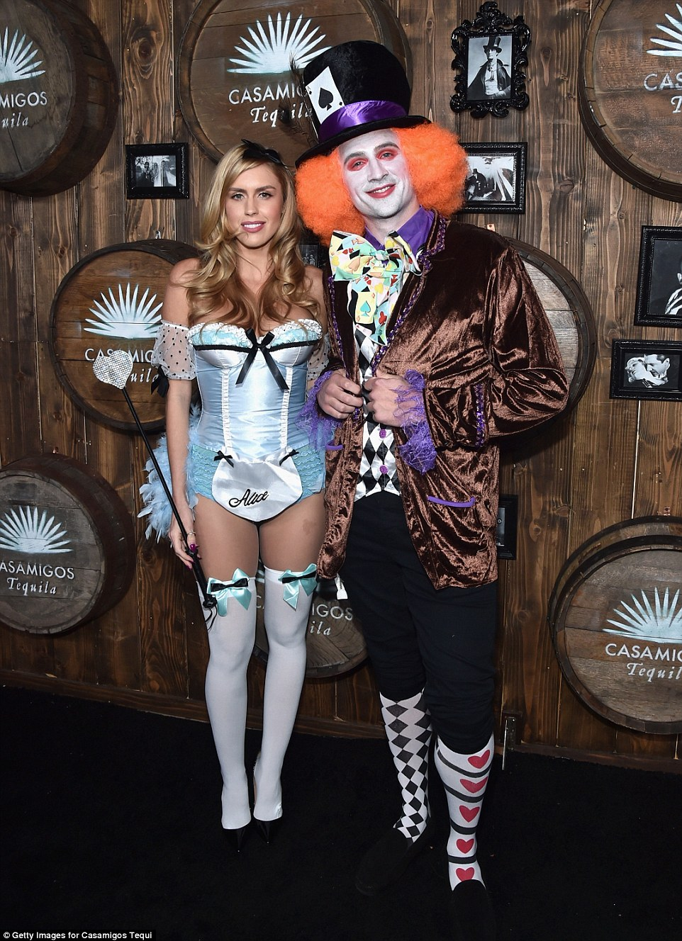Olympian Ryan Lochte and his fiancee Kayla Rae Reid wore coordinating Alice in Wonderland costumes on Friday