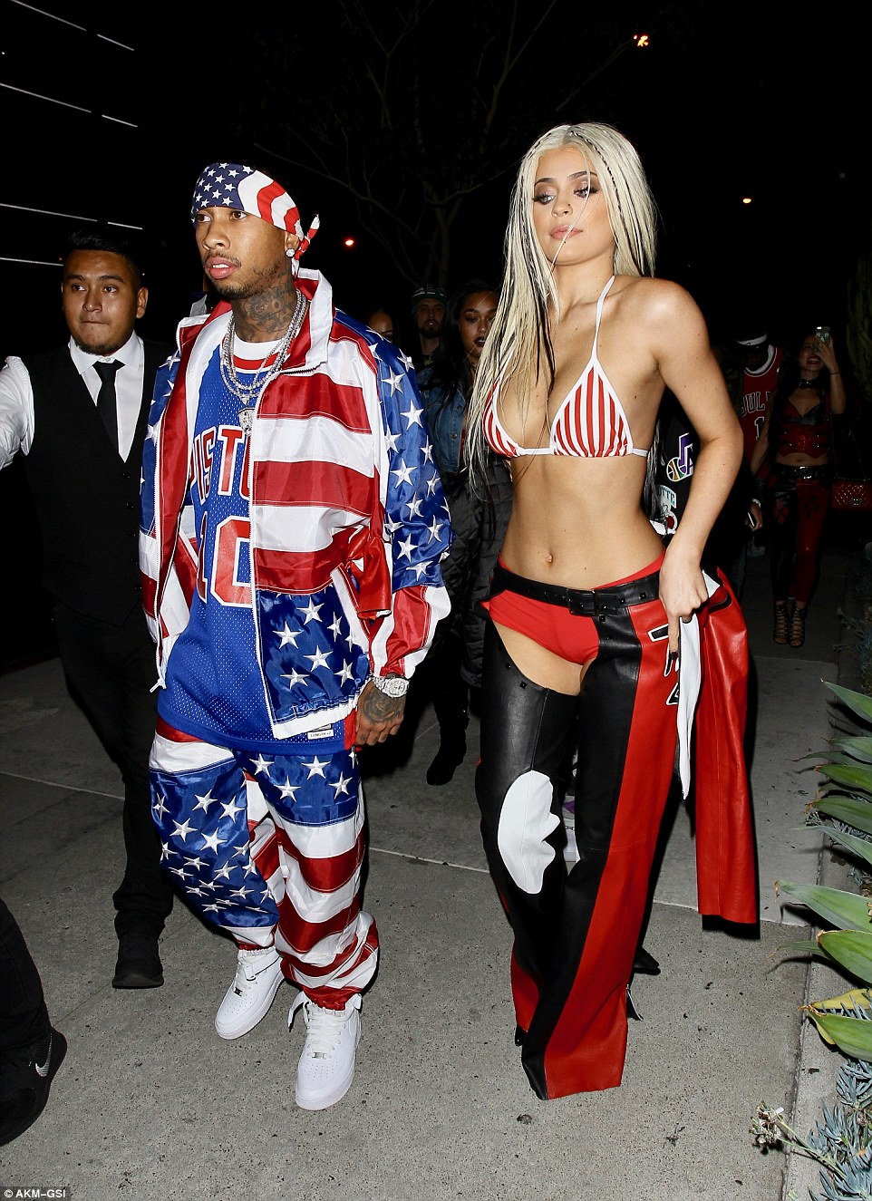 Kylie Jenner and her boyfriend Tyga dressed up in iconic outfits from the early 2000s, attending a Los Angeles party as Christina Aguilera from her Dirrty music video and as the rapper Juelz Santana