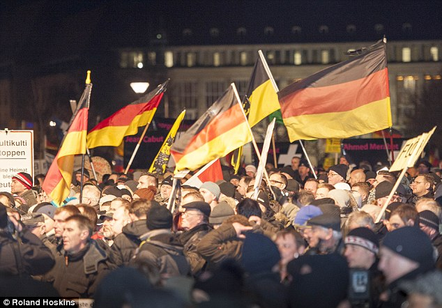 The statistics emerged against a backdrop of rising tensions over Merkel's liberal refugee policies. In October, thousands of protesters massed in the eastern German city of Dresden to mark the second anniversary of the anti-migrant and Islamophobic movement Pegida (file picture)