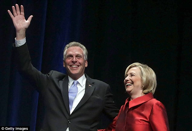 Best of friends: Virginia governor Terry McAuliffe with Hillary Clinton as she headlined a fundraiser for the PAC he controls. It then gave $500,000 to the wife of the now FBI deputy director for her own political ambitions