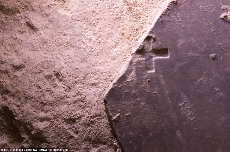 The tomb where Jesus Christ's body is said to have been rested was unveiled last week for the first time in centuries. As researchers continued their work over the course of 60 hours, another marble slab with a cross carved into its surface was exposed (pictured). Inscribed with a Christian cross, this broken marble slab may date to the Crusader era
