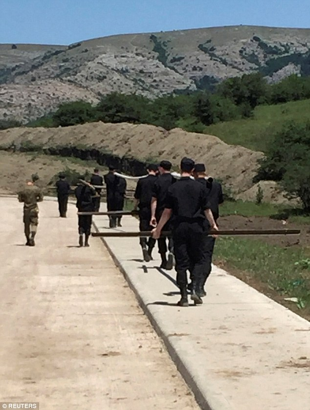 Russian servicemen pictured in Crimea in July, where resources are being strengthened amid increased tensions between Russia and NATO