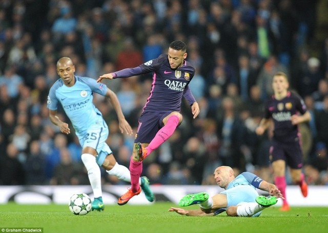 Neymar (centre) skips past City captain Pablo Zabaleta (right) during an end-to-end first-half in Manchester