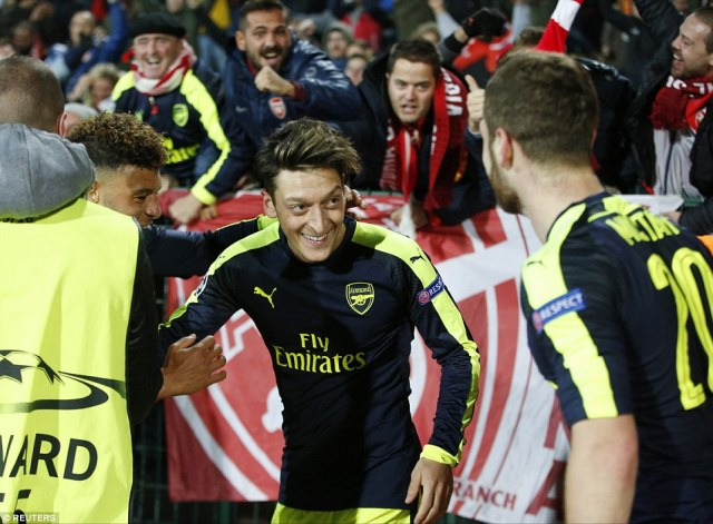 Ozil ran towards the Arsenal fans to celebrate his dramatic late winner which came after a piece of brilliant skill