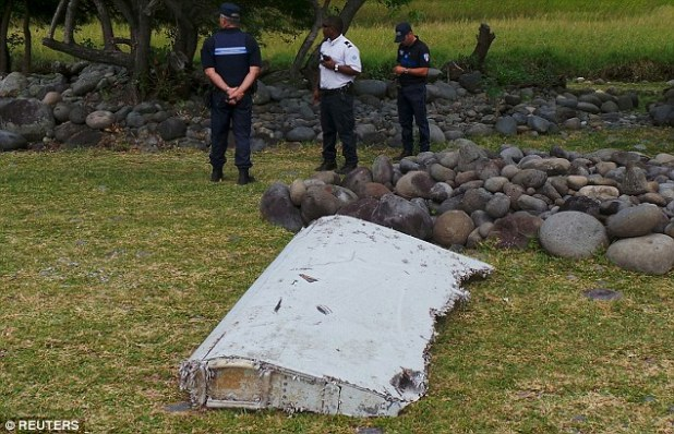 The flaperon, confirmed to be from MH370, washed up on Reunion Island off the eastern coast of Africa (pictured on discovery in July 2015)