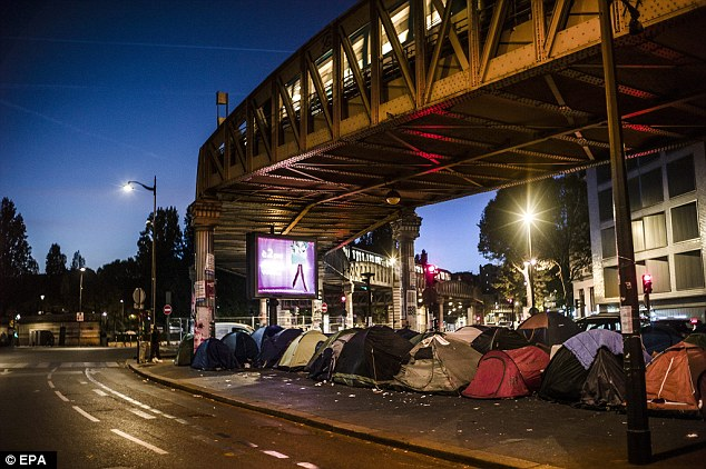 However, it is not the first time Russia has lashed out at the EU's handling of the migrant crisis after comments by thehead of Russia's Federal Migration Service. Pictured are migrants camping under a train line in Paris