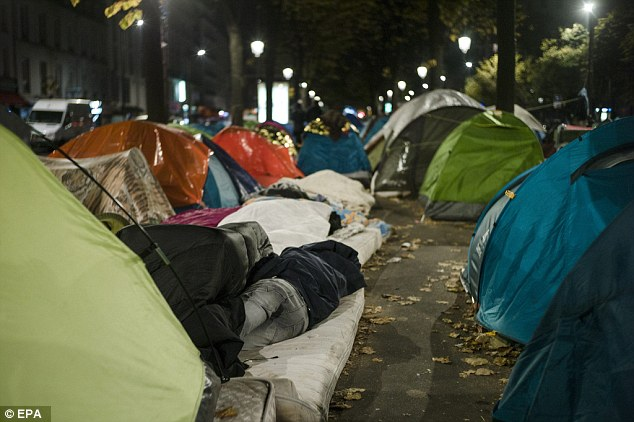 Konstantin Romodanovsky accused EU countries of ignoring the 'differences in culture, religious traditions, and customs' with the refugees, the vast majority of whom are Islamic. Pictured are migrants in Paris