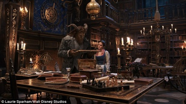 Unlikely couple: Standing alongside The Beast- played by Dan Stevens, the duo appear deep in conversation as they stand in an imposing library