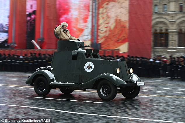 A Russian soldier in a World War Two era vehicle in Red Square yesterday. Despite its name Red Square was not named after the red flag of communism but dates from an earlier era