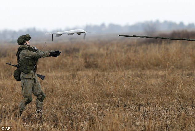 A Russian soldier launches a drone during the joint Russian, Belarusian and Serbian military exercise