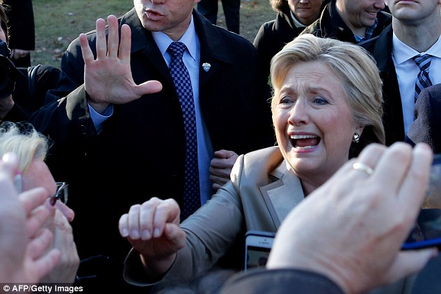 Hillary Clinton looked touched by the greeting she received at her local polling place by fellow New Yorkers as she cast her vote to become the nation's first female president