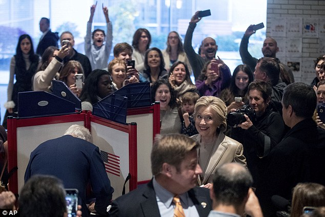A polling worker tried to calm the chaos - asking who was actually there to vote - as Hillary and Bill Clinton arrived at their polling place in New York this morning at 8 a.m.
