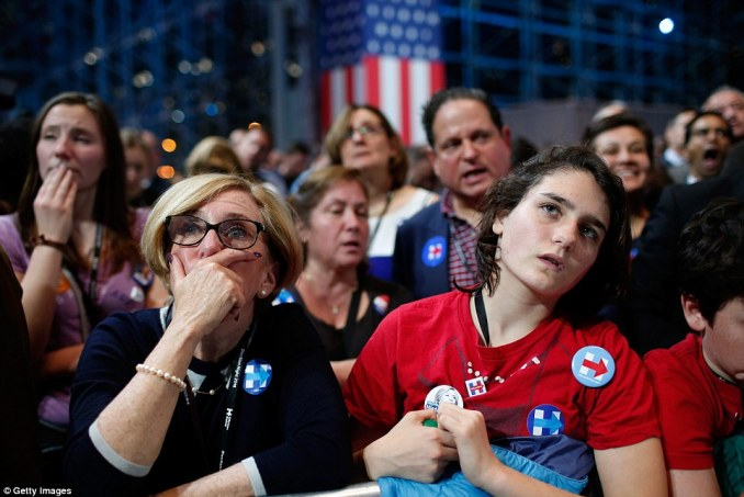 Clinton supporters watch in shock as Trump gains a lead in several states in the presidential election on Tuesday