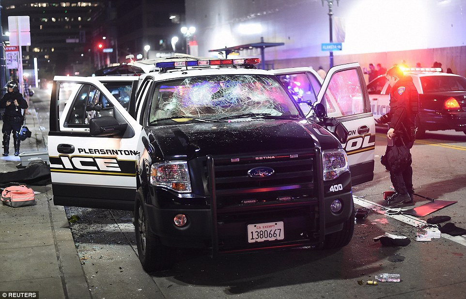 Oakland: Protesters also smashed up this police cruiser