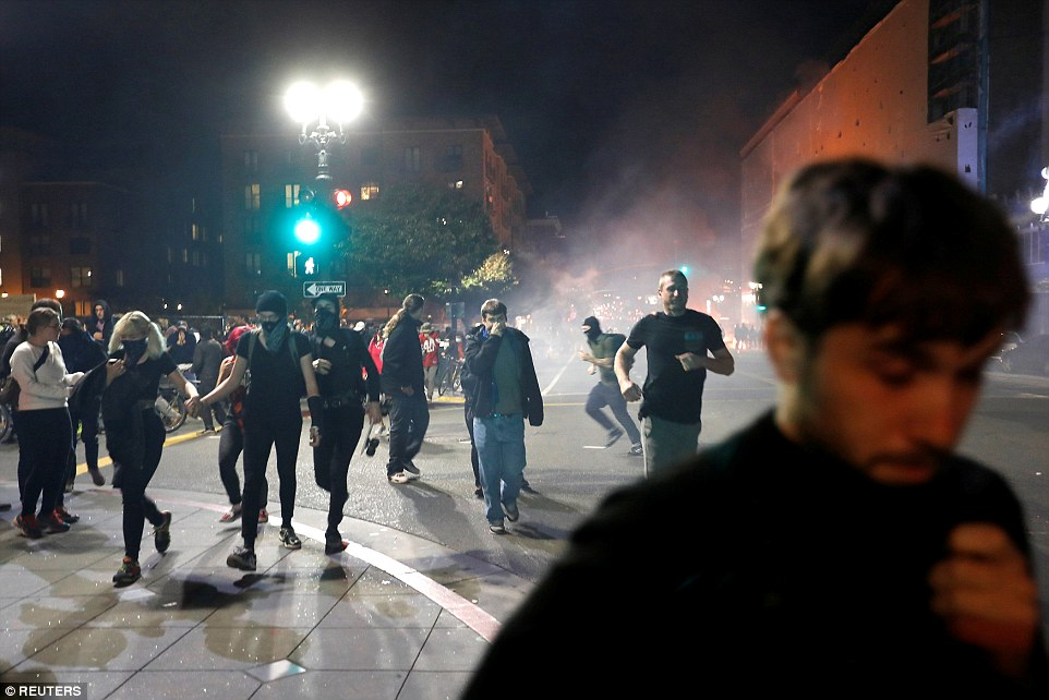 Oakland:Demonstrators run on Telegraph Avenue after police deployed teargas during a demonstration in the city