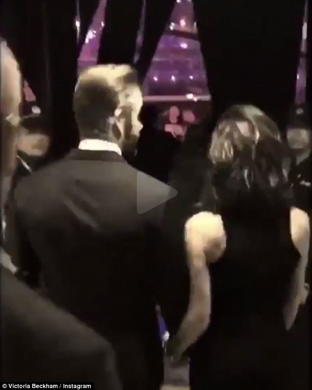 Hand-in-hand: The pair were seen in a video holding hands as they approached the stage