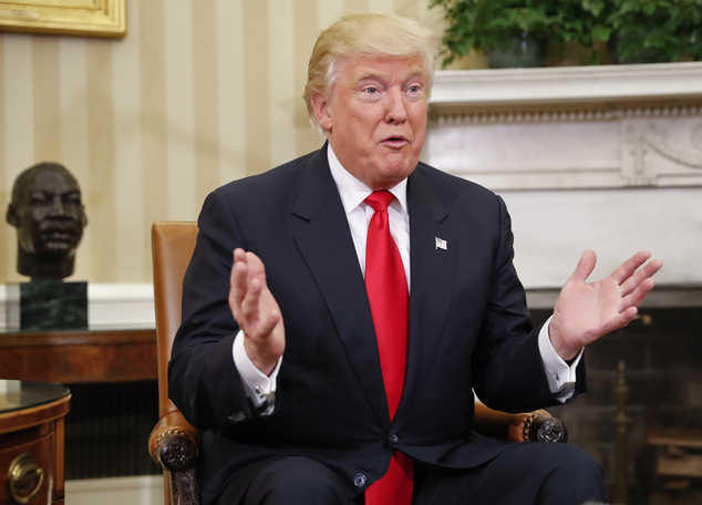 President-elect Donald Trump speaks to members of the media during his meeting with President Barack Obama in the Oval Office of the White House in Washingto...