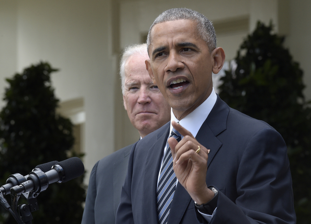 President Barack Obama, accompanied by Vice President Joe Biden, speaks about the election results, Wednesday, Nov. 9, 2016, in the Rose Garden at the White ...