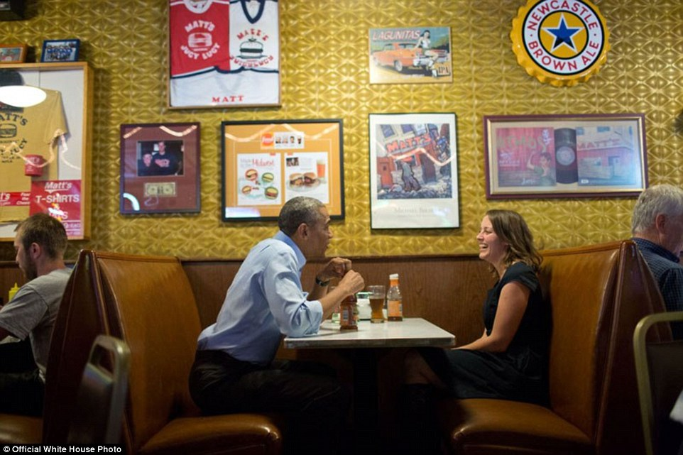 President Barack Obama has lunch with Rebekah Erler at Matt's Bar in Minneapolis, Minnesota, June 26, 2014. Erler, then a 36-year-old working wife and mother of two pre-school aged boys, had written the President a letter about economic difficulties