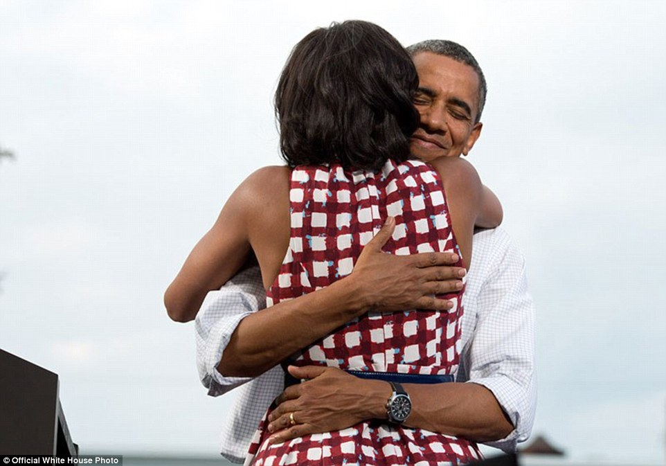August 15, 2012. 'The President hugs the First Lady after she had introduced him at a campaign event in Davenport, Iowa. The campaign tweeted a similar photo from the campaign photographer on election night and a lot of people thought it was taken on election day'