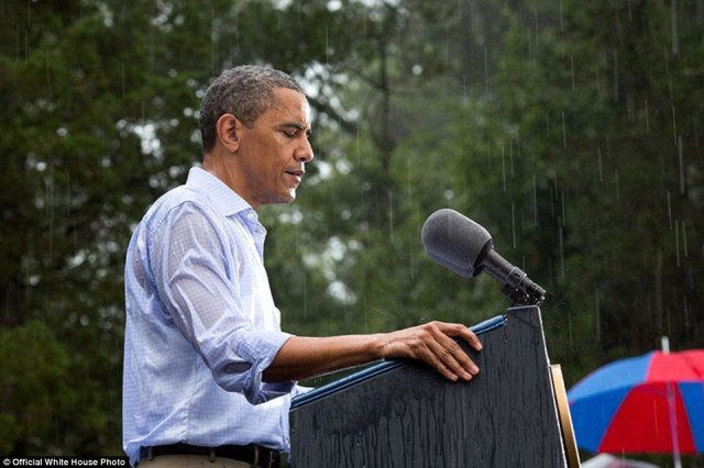 July 14, 2012. 'The President delivers remarks in the pouring rain at a campaign event in Glen Allen, Va. He was supposed to do a series of press interviews inside before his speech, but since people had been waiting for hours in the rain he did his remarks as soon as he arrived at the site so people could go home to dry off'