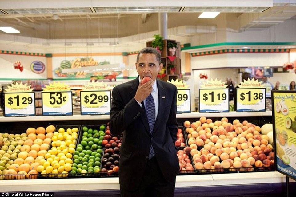 Bristol, Virginia - July 29, 2009. President Barack Obama eats a nectarine following a town hall meeting at Kroger's Supermarket