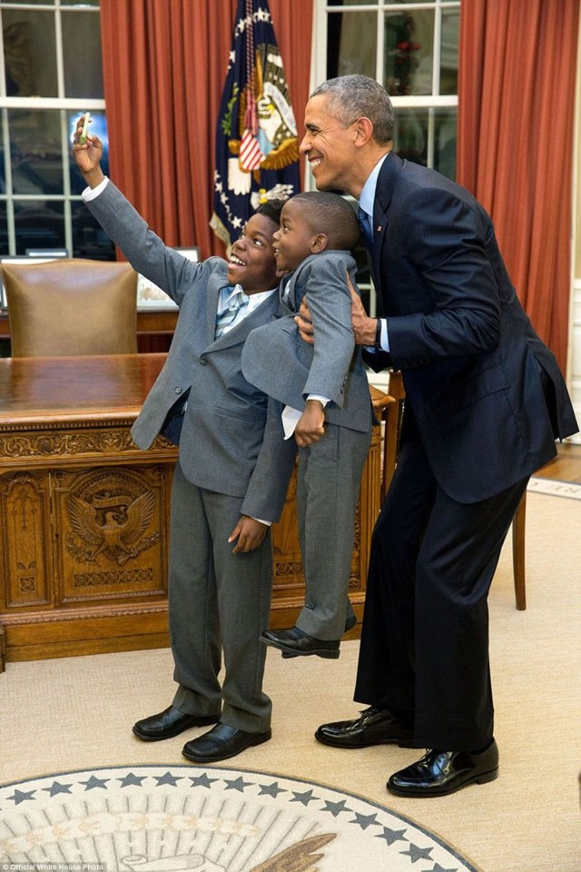 December 4, 2015. 'The President acquiesced to a selfie with 11-year-old Jacob Haynes and four-year-old James Haynes after taking a family photograph with departing White House staffer Heather Foster'