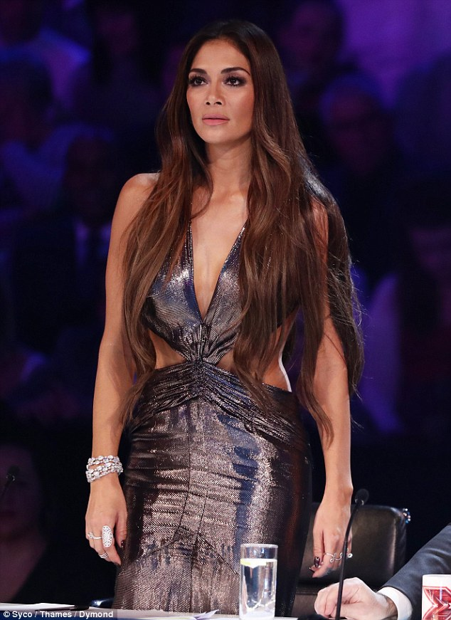 Brunette beauty: Nicole wore her brown hair long and loose around her shoulders