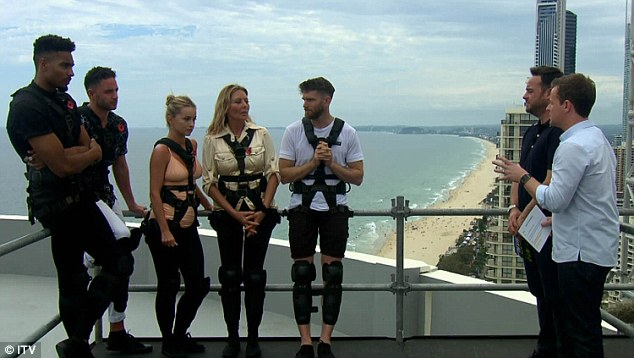 Flying high...For their first terrifying task, the fivesome were forced to walk along a narrow plank suspended on top of the Focus Tower on Australia's Gold Coast
