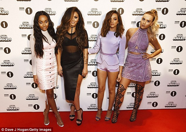 Top of the charts: Little Mix have every reason to celebrate following the smash reception of their new single Shout Out To My Ex, taken from their fourth album Glory Days