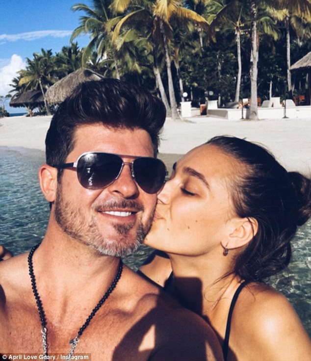Loved-up: The 21-year-old model is enjoying a break with the Blurred Lines hitmaker, 39, and took to Instagram to show off a bikini adorned with the initials 'ALT' - alluding to the fact she has taken his surname