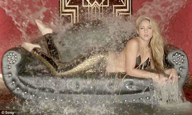 Smouldering:Shakira continues to shock as she posed in a super suggestive top which bared her entire back in the video for her collaboration with fellow Columbian singer Maluma, a song called Chantaje which translates as Blackmail