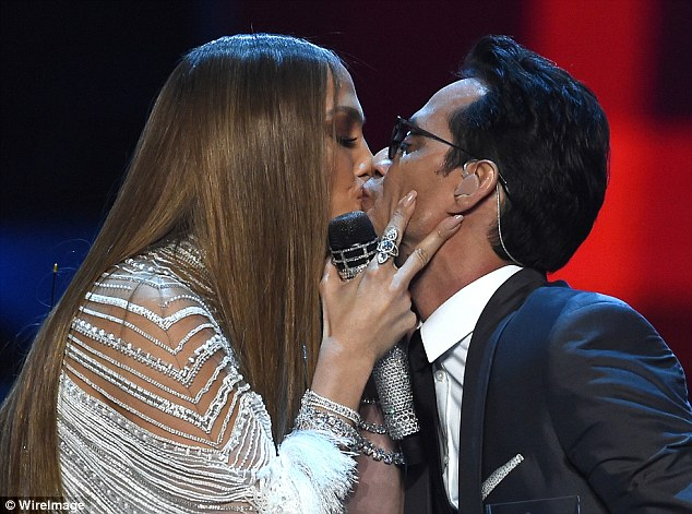 Kiss me quick!Jennifer surprised guests at the 17th annual Latin Grammy Awards on Thursday when she performed with and presented an award to her ex-husband Marc Anthony