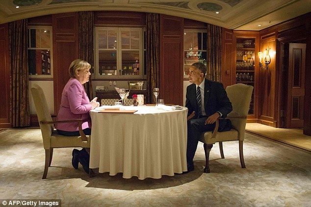 Mrs Merkel and Mr Obama enjoyed a one-on-one dinner at the Hotel Adlon in Berlin last night