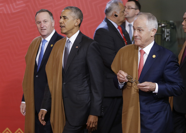 U.S. President Barack Obama, center, New Zealand's Prime Minister John Key, left, and Australia's Prime Minister Malcolm Turnbull arrive for the group photo APEC