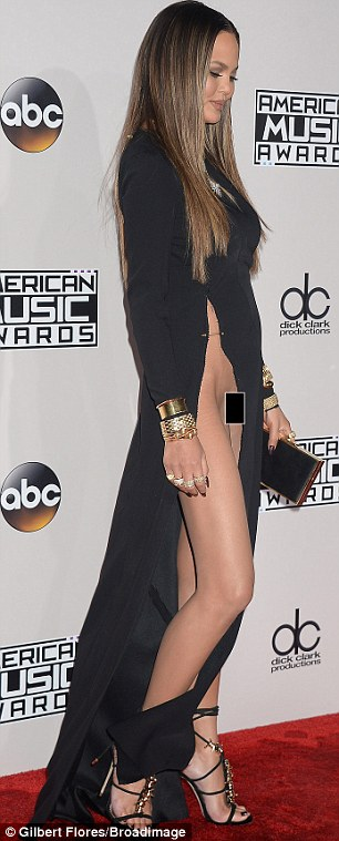 Over exposed:Chrissy Teigen suffered a wardrobe malfunction in a revealing black dress at the American Music Awards on Sunday