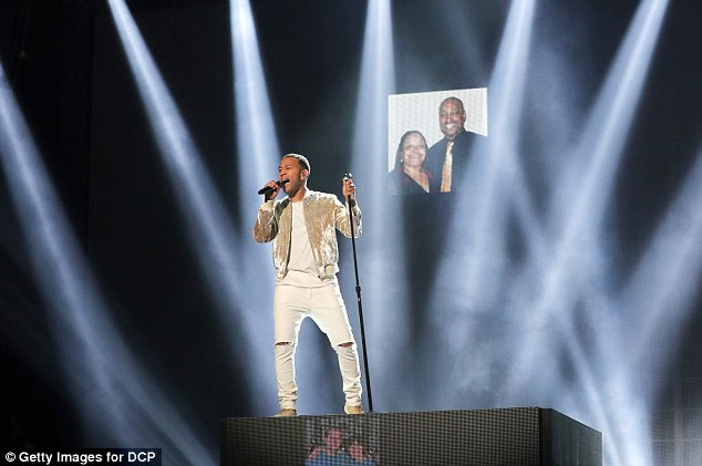 Looking good: The award winning artist hit the stage in a ripped white jeans with a matching top, adding a gold hued bomber jacket