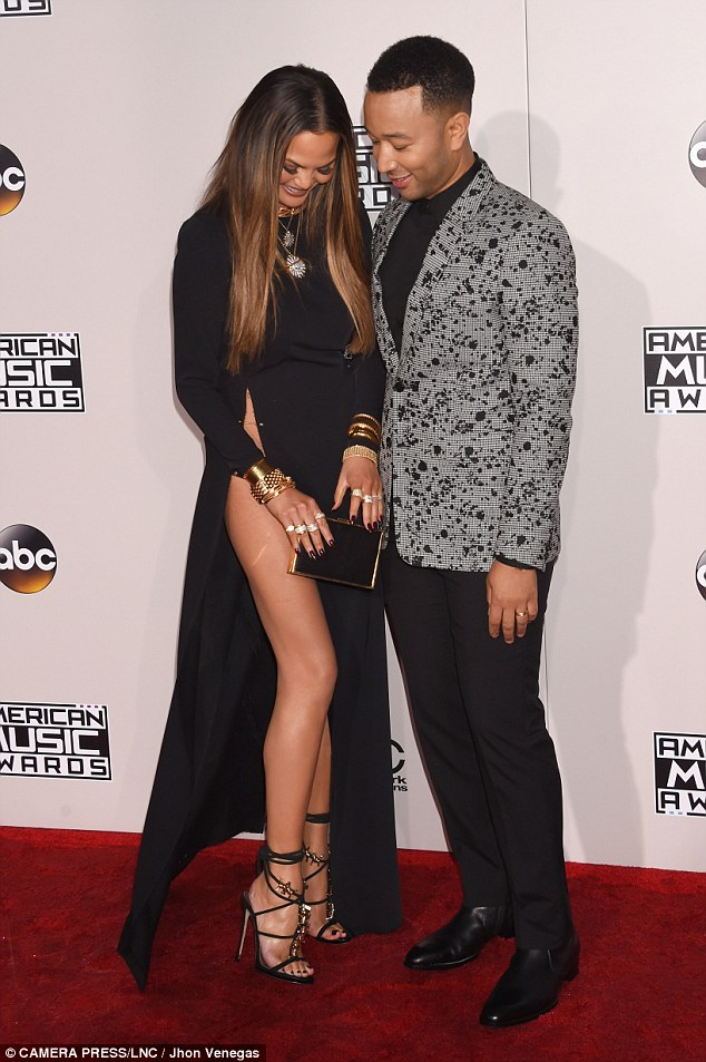Giggled: The celebrity couple, though, seemed nonplussed by the red carpet debacle
