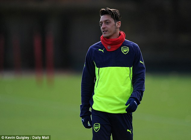 Ozil looks on during the session at London Colney ahead of Wednesday's clash