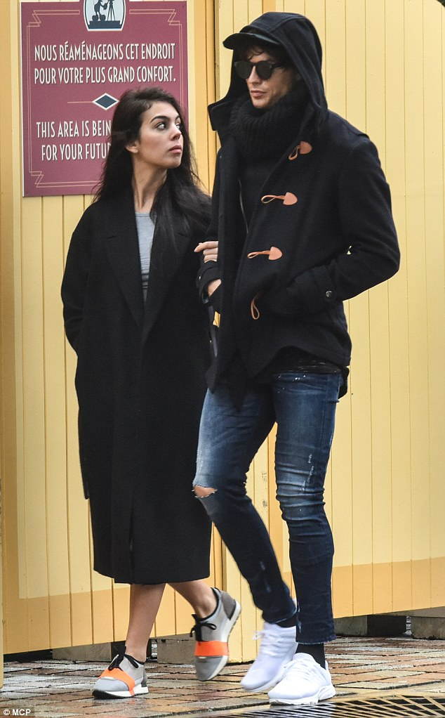 In good company: Real Madrid midfielder Cristiano Ronaldo was joined by new girlfriend Georgina Rodriguez for an incognito appearance at Disneyland Paris