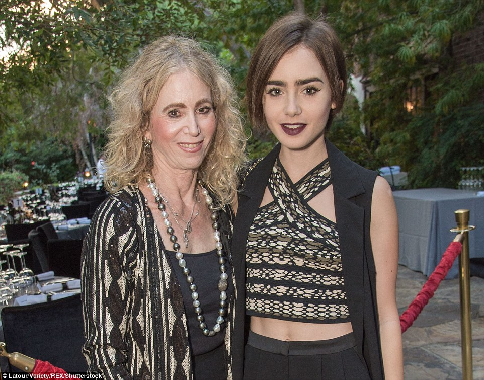 Ms Collins, left, with her daughter Lily, pictured at the party last year that they hosted at their mansion in Beverly Hills