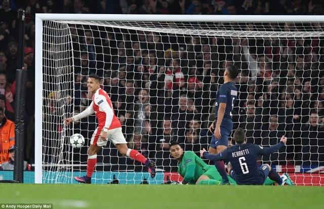 Alexis Sanchez wheels away in celebration as Arsenal took a 2-1 lead after PSG midfielder Marco Verratti scored an own goal