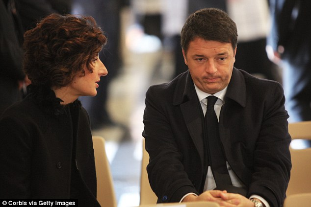 Early indications point to the vote on prime minister Matteo Renzi's (pictured, right) reforms being thrown out